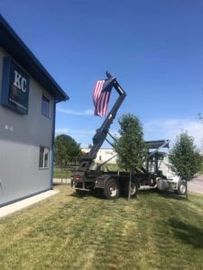 rental dumpster contact building truck and flag